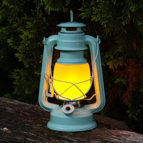 LED Sturmlaterne mit Flammeneffekt - Tragegriff - Batteriebetrieb - H: 24cm - pastellblau