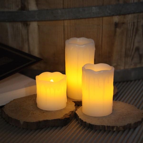 "LED Kerzenset ""Drip"" - Echtwachs - Schwungoberkante - Wachstropfen - flackernde LED - 3 Stück - weiß"